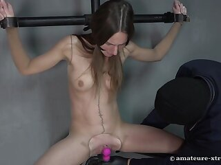 Skinny pussy fisting on the leg spreader