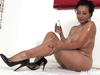 Oiled MILF Danica Collins takes gone her In US breeks plus fingers her pussy